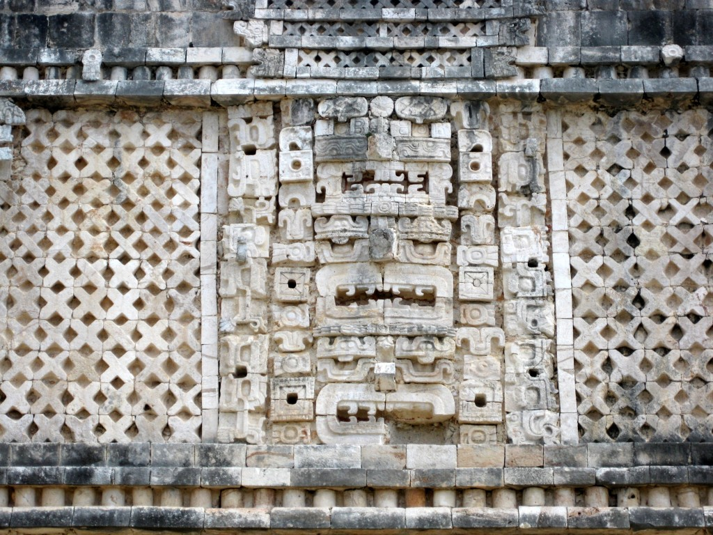 Lattice work surrounding the faces of Chaac—Mayan God of rain