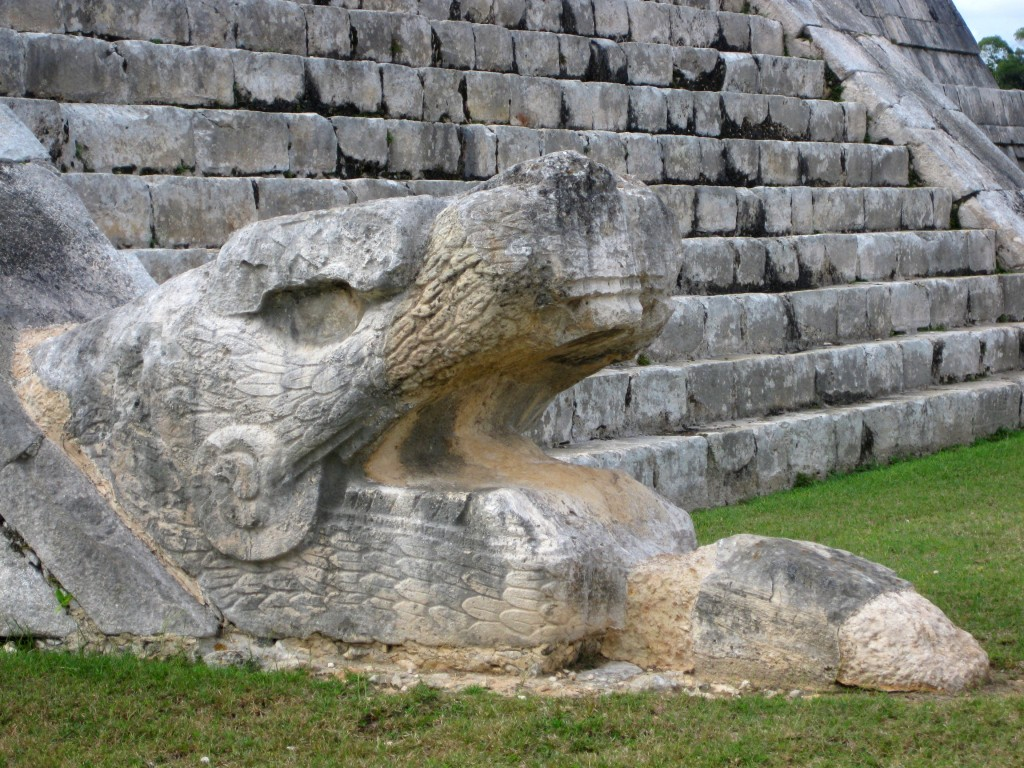 One of the two feathered serpents that run down the north side of El Castillo (aka Temple of Kukulcan)... ...Kukulcan is the Yucatec Maya Feathered Serpent deity