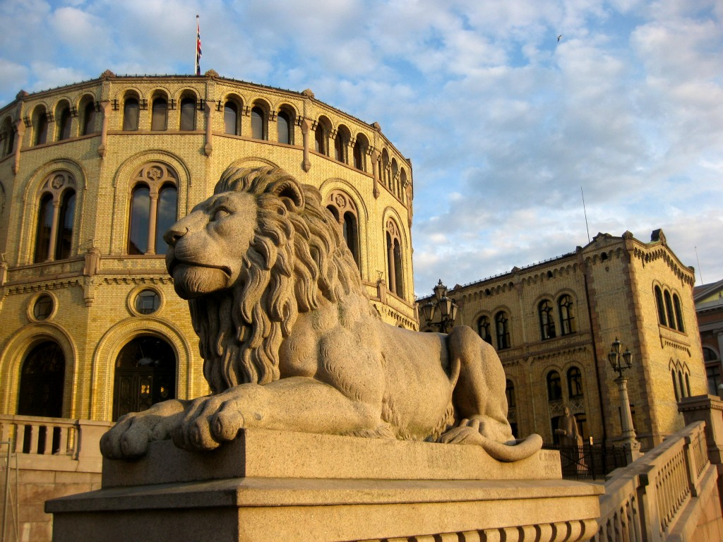 A majestic lion guarding the Storting (Parliament of Norway) building