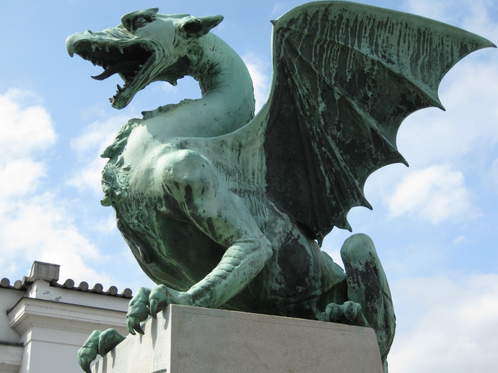 One of the four dragons, sitting on a pedestal at Dragon Bridge. That's a much better name for a bridge than its original name... ...The Jubilee Bridge of the Emperor Franz Josef I