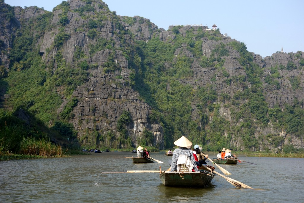 Boat ride along Ngô Đồng River amidst these karst mountains provides some seriously stunning views