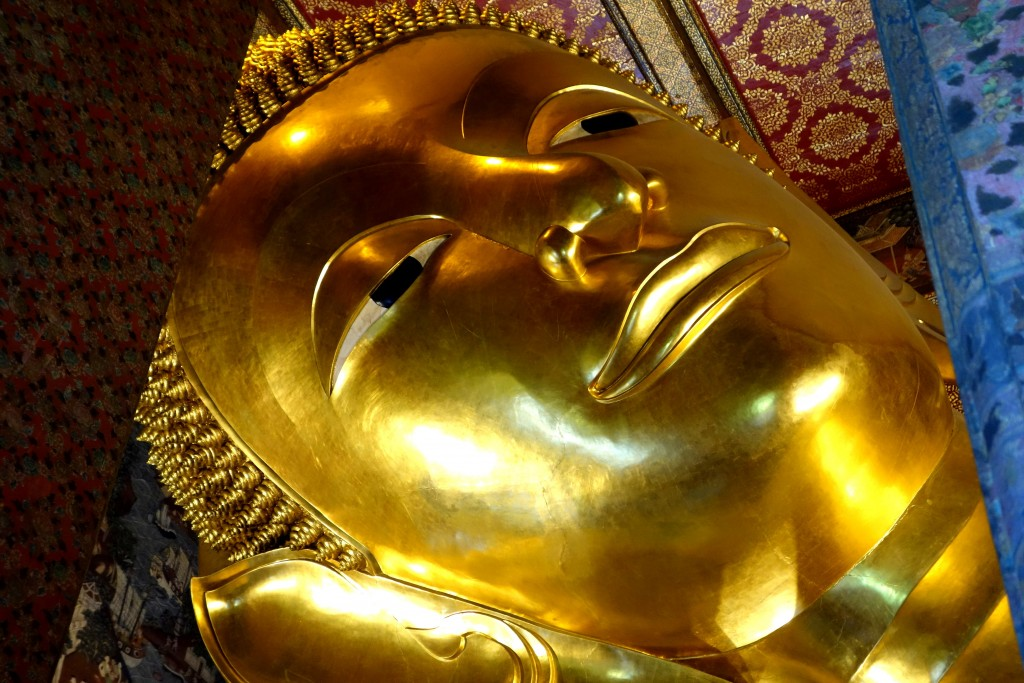Reclining Buddha in Wat Pho temple... ...the 15 m high and 43 m long statue represents the Buddha during his last illness, about to enter the parinirvana