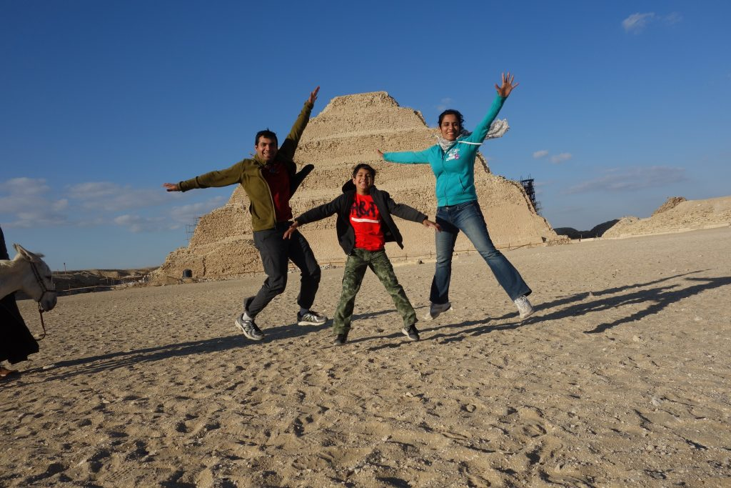 The donkey doesn't seem very amused at the sight of us jumping in front of the (step) Pyramid of Djoser